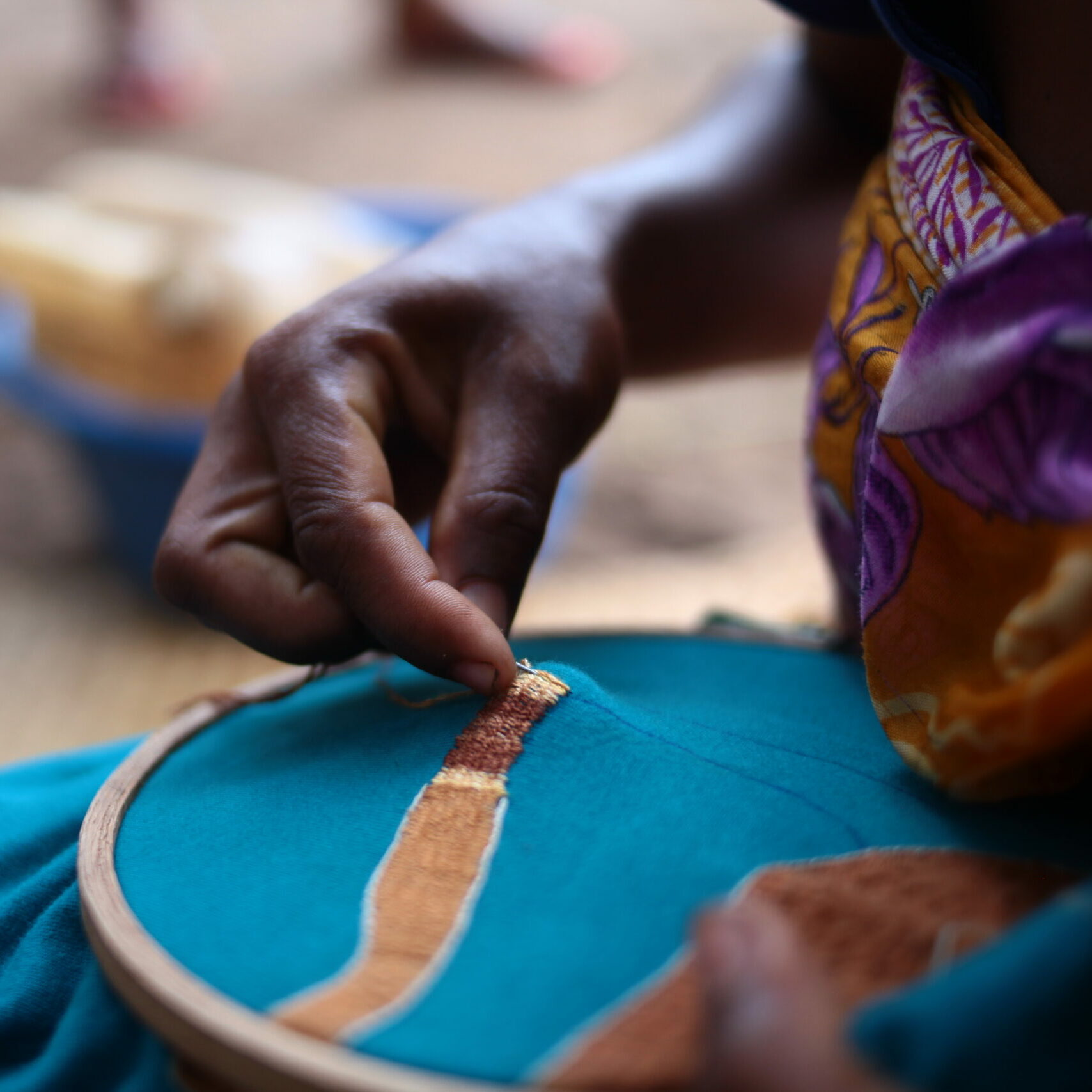 Local woman in Madagascar doing embroidery work