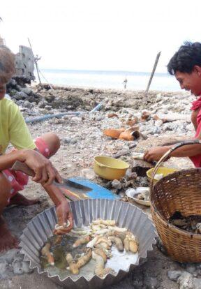 Women sorting fish, Philippines