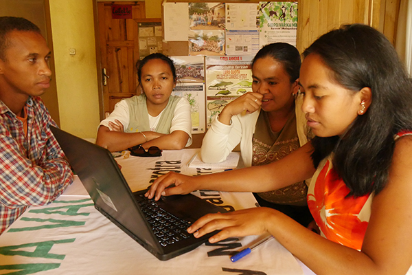 Jessica, MV team members and Dr Sylvaine Volampeno review project documents