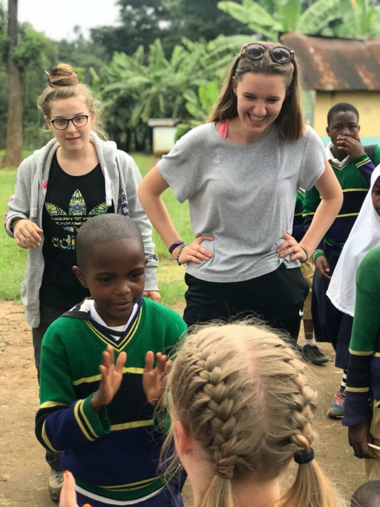 Playing with a group of children from a Tanzanian primary school